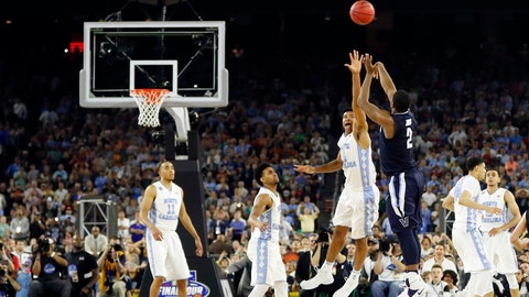 <p>               FILE - In this April 4, 2016, file photo, Villanova's Kris Jenkins makes the game-winning three-point shot during the second half of the NCAA Final Four college basketball championship game against North Carolina, in Houston. A panel of Associated Press sports writers has come up with the top 10 men's basketball games in the history of the NCAA Tournament. The top game on the list is Villanova's buzzer-beating victory against North Carolina in the 2016 national championship game. (AP Photo/David J. Phillip, File)             </p>