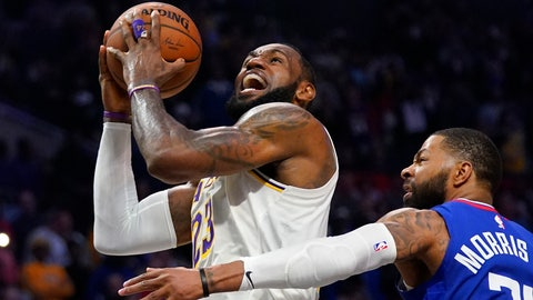 <p>               FILE - In this March 8, 2020, file photo, Los Angeles Lakers forward LeBron James, left, shoots as Los Angeles Clippers forward Marcus Morris Sr. defends during the second half of an NBA basketball game in Los Angeles. LeBron James says he probably won't feel any closure on the Los Angeles Lakers' remarkable season unless the NBA is able to finish its season. (AP Photo/Mark J. Terrill, File)             </p>
