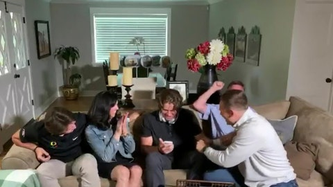<p>               In this still image from video provided by the NFL, Justin Herbert holds his phone during the NFL football draft Thursday, April 23, 2020. The Los Angeles Chargers selected Herbert with the sixth pick. (NFL via AP)             </p>