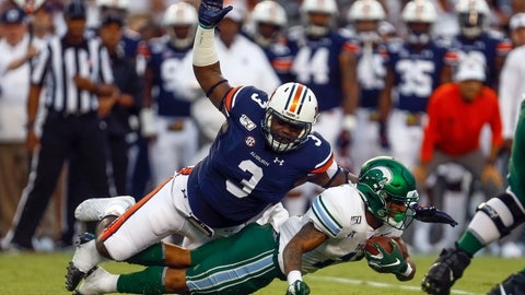 <p>               FILE - In this Sept. 7, 2019, file photo, Tulane running back Amare Jones is tackled for a loss by Auburn defensive end Marlon Davidson (3) during the first quarter of an NCAA college football game in Auburn, Ala. Davidson was selected by the Atlanta Falcons in the second round of the NFL football draft Friday, April 24, 2020. (AP Photo/Butch Dill, File)             </p>