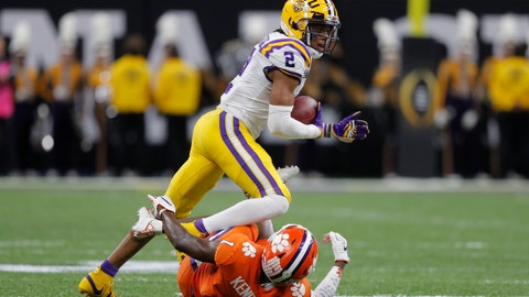 <p>               LSU wide receiver Justin Jefferson runs over Clemson cornerback Derion Kendrick during the first half of a NCAA College Football Playoff national championship game Monday, Jan. 13, 2020, in New Orleans. (AP Photo/Gerald Herbert)             </p>