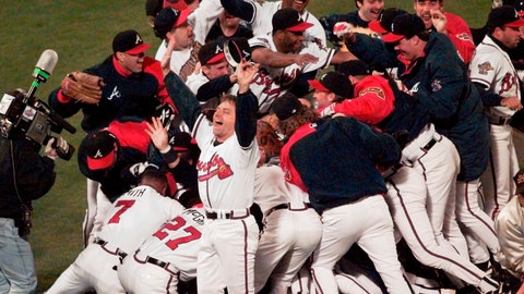 <p>               FILE - In this Oct. 28, 1995, file photo, the Atlanta Braves celebrate after Game 6 of the World Series against the Cleveland Indians in Atlanta. The Braves beat the Cleveland Indians 1-0 to win the best-of-seven series. Twenty-five years ago, Atlanta sports finally reached the promised land. With the world in the grips of coronavirus pandemic, it's a welcome respite to remember when the Braves gave the city its first major championship. (AP Photo/Ed Reinke, File)             </p>
