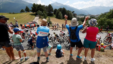 <p>               FILE - In this file photo taken on July 26, 2019 spectators along the road applaud the riders during the nineteenth stage of the Tour de France cycling race between Saint Jean De Maurienne and Tignes. Swarms of fans clog the city streets, winding roads and soaring mountain passes of the Tour de France during cycling's three-week showpiece. But unlike almost every other major sporting event it has yet to be called off because of the coronavirus and the start date remains June 27. The new coronavirus causes mild or moderate symptoms for most people, but for some, especially older adults and people with existing health problems, it can cause more severe illness or death. (AP Photo/Thibault Camus, File)             </p>