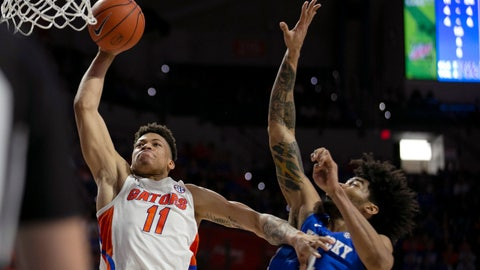 <p>               Florida forward Keyontae Johnson (11) goes for the dunk against Kentucky forward Nick Richards (4) during the first half of an NCAA college basketball game Saturday, March 7, 2020, in Gainesville, Fla. (AP Photo/Alan Youngblood)             </p>