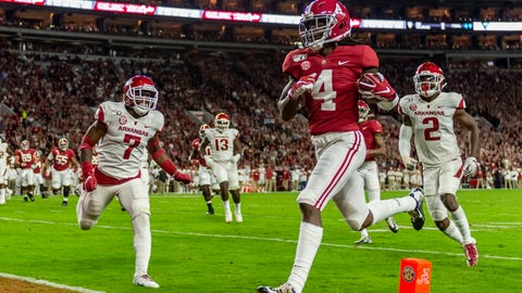 <p>               FILE - In this Oct. 26, 2019, file photo, Alabama wide receiver Jerry Jeudy (4) scores on a pass reception against Arkansas during the first half of an NCAA college football game in Tuscaloosa, Ala. The Denver Broncos selected Jeudy in the first round of the NFL draft. (AP Photo/Vasha Hunt, File)             </p>