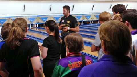 <p>               In this April 20, 2013 photo, Australian pro bowler Jason Belmonte, center, gives instructions during a clinic on the Sunshine Coast, Australia. Belmonte's return to Australia from another banner season on the PBA Tour in the United States was never going to be easy due to a logjam of Australians trying to return Down Under because of the coronavirus shutdown. (AP Photo/Dennis Passa)             </p>