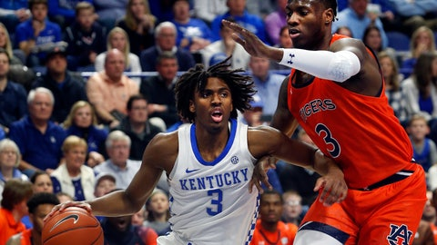 <p>               Kentucky's Tyrese Maxey, left, drives near Auburn's Danjel Purifoy, right, during the first half of an NCAA college basketball game in Lexington, Ky., Saturday, Feb. 29, 2020. (AP Photo/James Crisp)             </p>
