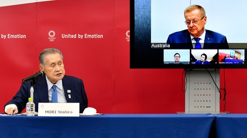 <p>               Tokyo 2020 Organizing Committee President Yoshiro Mori, left, speaks in teleconference with John Coates, chairman of the IOC's Coordination Commission for the Tokyo 2020 Olympic Games, in Tokyo Thursday, April 16, 2020. Tokyo Olympic organizers and the IOC said Thursday they will cut some of the extras out of next year's postponed games, an attempt to limit what is expected to be billions of dollars in added expenses.(Kazuhiro Nogi/Pool Photo via AP)             </p>