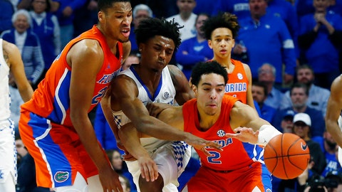<p>               Kentucky's Ashton Hagans, middle, is sandwiched between Florida's Andrew Nembhard (2) and Kerry Blackshear Jr., left, in the second half of an NCAA college basketball game in Lexington, Ky., Saturday, Feb. 22, 2020. Kentucky won 65-59. (AP Photo/James Crisp)             </p>
