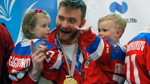 <p>               FILE - In this Feb. 26, 2018, file photo, Russian ice hockey player Mikhail Grigorenko holds his children after arriving at Sheremetyevo airport, outside Moscow, Russia from the Olympics in Pyeongchang, South Korea. Blue jackets general manager Jarmo Kekalainen announced the signing Monday, April 20, 2020, of forward Mikhail Grigorenko to a one-year contract for the 2020-21 season. A person with knowledge of the contract says it's worth $1.2 million. The person spoke to The Associated Press on condition of anonymity because the team does not release contract terms.(AP Photo/Pavel Golovkin, File)             </p>