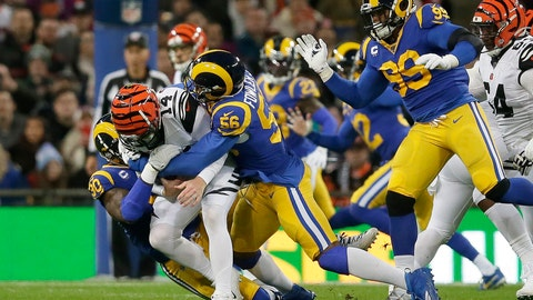 <p>               FILE - In this Oct. 27, 2019, file photo, Cincinnati Bengals quarterback Andy Dalton (14) is sacked by Los Angeles Rams defensive end Michael Brockers (90) and defensive end Dante Fowler (56) during the first half of an NFL football game at Wembley Stadium in London. A person familiar with the deal says the Atlanta Falcons have agreed to sign outside linebacker Dante Fowler. The person spoke to The Associated Press on condition of anonymity because free-agent signings can't be announced until after the league year begins Wednesday afternoon, March 18, 2020. (AP Photo/Tim Ireland, File)             </p>