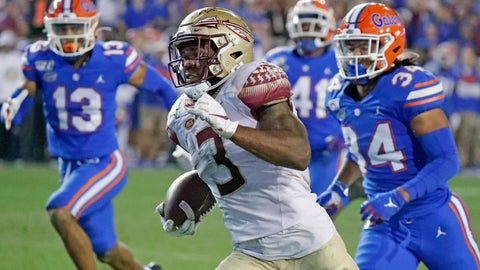 <p>               FILE - In this Nov. 30, 2019, file photo, Florida State running back Cam Akers (3) runs for a 50-yard touchdown past Florida linebacker Lacedrick Brunson (34) and defensive back Donovan Stiner (13) during the second half of an NCAA college football game in Gainesville, Fla. Akers was selected by the Los Angeles Rams in the second round of the NFL football draft Friday, April 24, 2020. (AP Photo/John Raoux)             </p>