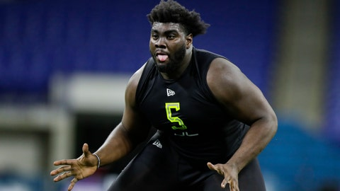<p>               FILE - In this Feb. 28, 2020, file photo, Louisville offensive lineman Mekhi Becton runs a drill at the NFL football scouting combine in Indianapolis. Becton was chosen by the New York Jets in the first round of the NFL draft. (AP Photo/Michael Conroy, File)             </p>