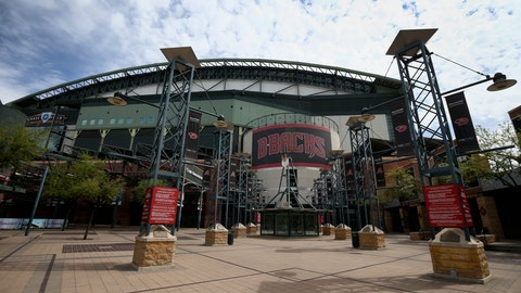 <p>               FILE - In this Thursday, March 26, 2020 file photo, The main entrance in front of Chase Field is devoid of activity in Phoenix. Putting all 30 teams in the Phoenix area this season and playing in empty ballparks was among the ideas discussed Monday, April 6, 2020 during a call among five top officials from MLB and the players' association that was led by Commissioner Rob Manfred, people familiar with the discussion told The Associated Press.  (AP Photo/Ross D. Franklin, File)             </p>