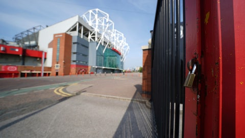 <p>               A padlocked gate stands near the closed Manchester United stadium, Old Trafford, in Manchester, northern England, as the English Premier League soccer season has been suspended due to coronavirus, Thursday, April 9, 2020. The new coronavirus causes mild or moderate symptoms for most people, but for some, especially older adults and people with existing health problems, it can cause more severe illness or death. (AP Photo/Jon Super)             </p>