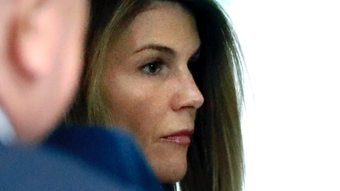 <p>               FILE - In this Aug. 27, 2019, file photo, Lori Loughlin enters through the back door at federal court in Boston for a hearing in a nationwide college admissions bribery scandal. Federal prosecutors in a legal document filed late Wednesday, April 8, 2020, denied allegations that investigators deliberately withheld and fabricated evidence to entrap actress Loughlin, her fashion designer husband Mossimo Giannulli and other prominent parents charged with cheating the college admissions process. (AP Photo/Steven Senne, File)             </p>