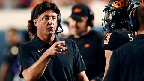<p>               FILE - In this Sept. 28, 2019, file photo, Oklahoma State head coach Mike Gundy points to his staff on the sideline during the first half of an NCAA college football game against Kansas State in Stillwater, Okla. Gundy apologized Saturday, April 11, 2020, for comments this week about the COVID-19 pandemic. (AP Photo/Brody Schmidt, File)             </p>