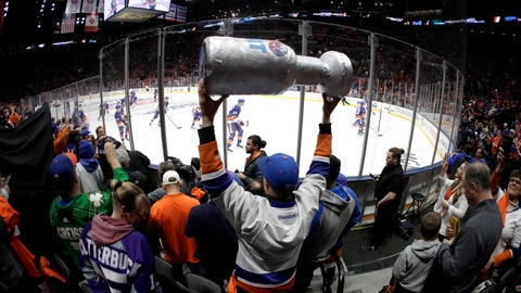 <p>               FILE - In this April 10, 2019, file photo, New York Islanders players take the ice as a man holds a makeshift Stanley Cup prior to Game 1 of an NHL hockey first-round playoff series against the Pittsburgh Penguins in Uniondale, N.Y. (AP Photo/Julio Cortez, FIle)             </p>