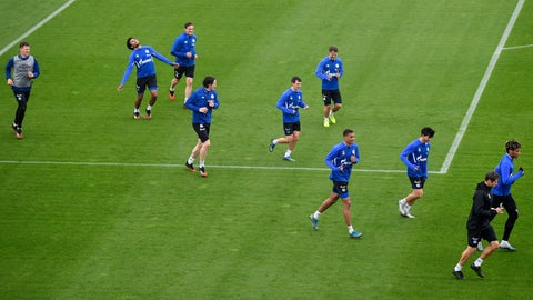 <p>               US national player Weston McKennie, second from left, exercises with his Bundesliga team of soccer club FC Schalke 04 during a training session in Gelsenkirchen, Germany, Wednesday, April 29, 2020. Despite a ban in Germany on all large gatherings through the end of August to fight the coronavirus pandemic, soccer officials are hoping to restart the league without spectators in May. (AP Photo/Martin Meissner)             </p>
