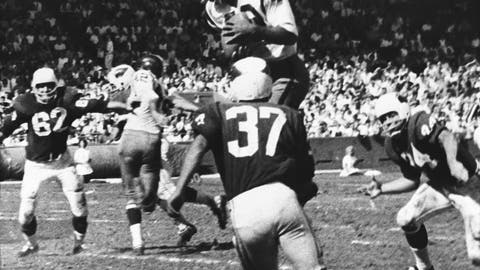 <p>               FILE - In this Oct. 15, 1962, file photo, Bobby Mitchell, of the Washington Redskins, jumps to haul in a pass from quarterback Norman Snead in the second period of their NFL football game against the St. Louis Cardinals in St. Louis. Mitchell, the speedy late 1950s and '60s NFL offensive star the Cleveland Browns and the Redskins, has died. He was 84. The Pro Football Hall of Fame said Sunday night, April 5, 2020, that Mitchell's family said he died in the afternoon. (AP Photo/Fred Waters, File)             </p>