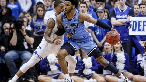 <p>               Villanova's Saddiq Bey (41) drives against Seton Hall's Shavar Reynolds, left, during the second half of an NCAA college basketball game Wednesday, March 4, 2020, in Newark, N.J. (AP Photo/John Minchillo)             </p>
