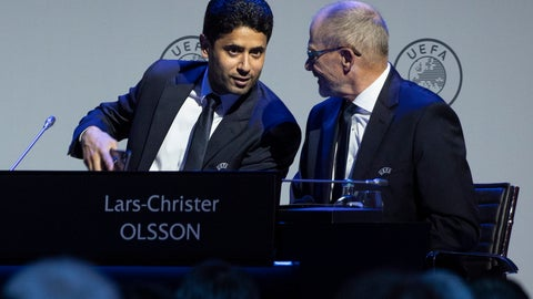 <p>               Nasser Al-Khelaifi, left, talks to Lars-Christer Olsson, right, during a meeting of European soccer leaders at the congress of the UEFA governing body in Amsterdam's Beurs van Berlage, Netherlands, Tuesday, March 3, 2020. (AP Photo/Peter Dejong)             </p>