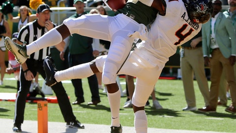 <p>               FILE - In this Nov. 3, 2018, file photo, Baylor's wide receiver Denzel Mims, left, pulls down the game winning touchdown over Oklahoma State's cornerback A.J. Green, right, in the second half of an NCAA college football game in Waco, Texas. Mims is a possible pick in the NFL Draft which runs Thursday, April 23, 2020 thru Saturday, April 25. (Michael Bancale/Waco Tribune-Herald via AP, File)             </p>