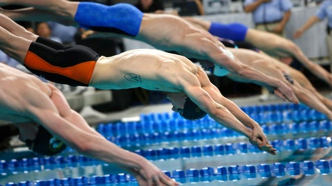 <p>               FILE - In this Jan. 17, 2016, file photo, Andrew Wilson, center, competes in the men's 100-meter breaststroke during the Arena Pro Swim Series in Austin, Texas. USA Swimming has announced its plans for a return to competition, beginning with a series of regional events in August before the national schedule begins in early November at Richmond, Virginia. (AP Photo/Stephen Spillman, File)             </p>