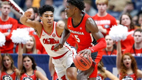 <p>               Georgia guard Anthony Edwards (5) drives against Mississippi's Breein Tyree (4) in the second half of an NCAA college basketball game in the Southeastern Conference Tournament Wednesday, March 11, 2020, in Nashville, Tenn. Georgia won 81-63. (AP Photo/Mark Humphrey)             </p>