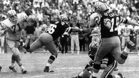 <p>               FILE - In this Nov. 8, 1970, file photo, New Orleans Saints' Tom Dempsey (19) moves up to kick a 63-yard field goal as teammate Joe Scarpati holds the ball and Detroit Lions' Alex Karras (71) rushes in while Saints' Bill Cody (66) blocks, in New Orleans. Dempsey, who played in the NFL despite being born without toes on his kicking foot and made a record 63-yard field goal, died late Saturday, April 4, 2020, in New Orleans while struggling with complications from the new coronavirus, his daughter said. He was 73 years old. (AP Photo/File)             </p>