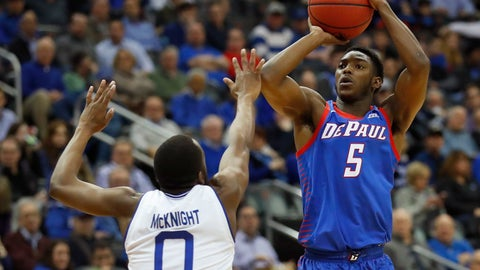 <p>               DePaul's Jalen Coleman-Lands (5) takes a jump shot against Seton Hall's Quincy McKnight (0) during the first half of an NCAA college basketball game Wednesday, Jan. 29, 2020, in Newark, N.J. (AP Photo/Noah K. Murray)             </p>