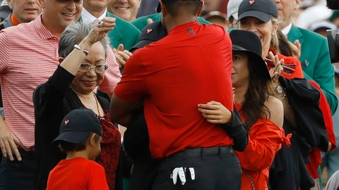 <p>               FILE - In this April 14, 2019 file photo, Tiger Woods hugs his family after winning the Masters golf tournament in Augusta, Ga. His reaction when he won, with his children there, stood out among the other 14 majors Woods has won. (AP Photo/Matt Slocum, File)             </p>