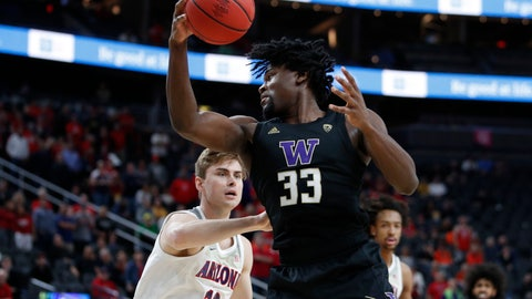 <p>               Washington's Isaiah Stewart (33) grabs a rebound over Arizona's Stone Gettings (13) during the first half of an NCAA college basketball game in the first round of the Pac-12 men's tournament Wednesday, March 11, 2020, in Las Vegas. (AP Photo/John Locher)             </p>