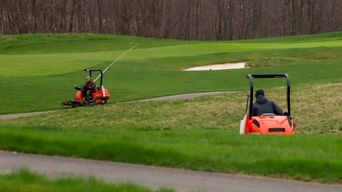 <p>               Workers at the Cranberry Highlands Golf Course maintain the course despite it being closed indefinitely in efforts to help stop the spread of the coronavirus, Monday, March 30, 2020, in Cranberry Township, Pa. The web site for the course also said that they had cancelled all events through April 12, 2020. (AP Photo/Keith Srakocic)             </p>