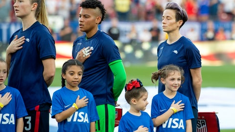<p>               United States midfielder Samantha Mewis (3), goalkeeper Adrianna Franch, center, and forward Megan Rapinoe, right, stand with their jerseys turned inside out during the playing of the national anthem before a SheBelieves Cup women's soccer match against Japan, Wednesday, March 11, 2020 at Toyota Stadium in Frisco, Texas. (AP Photo/Jeffrey McWhorter)             </p>