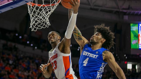 <p>               Florida guard Scottie Lewis (23) shots against Kentucky forward Nick Richards (4) during the first half of an NCAA college basketball game Saturday, March 7, 2020, in Gainesville, Fla. (AP Photo/Alan Youngblood)             </p>