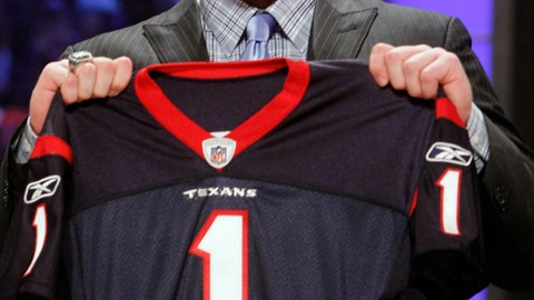 <p>               FILE - In this April 28, 2011, file photo, Wisconsin defensive end J.J. Watt holds up a jersey after he was selected as the 11th overall pick by the Houston Texans in the first round of the NFL football draft at Radio City Music Hall  in New York. He was booed by Texans fans when he was selected with the 11th overall pick in the 2011 draft. But it didn't take Watt long to win over the fan base and become the most beloved Texan of all time. (AP Photo/Jason DeCrow, File)             </p>