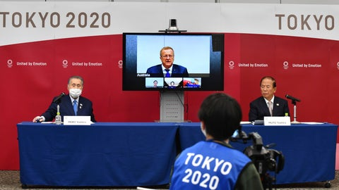 <p>               Tokyo 2020 Organizing Committee President Yoshiro Mori, left, and CEO Toshiro Muto, right, attend teleconference with International Olympic Committee member John Coates, who heads the inspection team for Tokyo Olympics, in Tokyo Thursday, April 16, 2020. Tokyo Olympic organizers and the IOC said Thursday they will cut some of the extras out of next year's postponed games, an attempt to limit what is expected to be billions of dollars in added expenses.(Kazuhiro Nogi/Pool Photo via AP)             </p>
