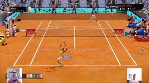 """<p>               A screen grab taken on Monday April 27, 2020 showing Spain's Rafael Nadal, bottom left, playing against Canada's Denis Shapovalov, bottom right, in a """"virtual"""" tennis match at a tournament hosted by the Madrid Open. Tennis has joined the video game craze taking over the sports world during the coronavirus pandemic, with Rafael Nadal, Andy Murray and 30 other pros trading in their rackets for controllers this week to participate in a """"virtual"""" tournament hosted by the Madrid Open. (Mutua Madrid Open via AP)             </p>"""