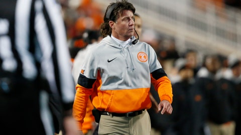 <p>               In this Nov. 30, 2019 file photo Oklahoma State head coach Mike Gundy walks on the sidelines during an NCAA college football game against Oklahoma in Stillwater, Okla. Gundy said Tuesday, April 7, 2020 he hopes to have his team return to its facilities on May 1, a proposed timetable that would defy federal social-distancing guidelines and was quickly disputed by the university and its athletic director. (AP Photo/Sue Ogrocki)             </p>
