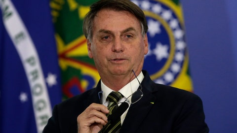 <p>               Brazil's President Jair Bolsonaro speaks during the inauguration ceremony of the newly appointed justice minister, at the Planalto presidential palace, in Brasilia, Brazil, Wednesday, April 29, 2020. (AP Photo / Eraldo Peres)             </p>