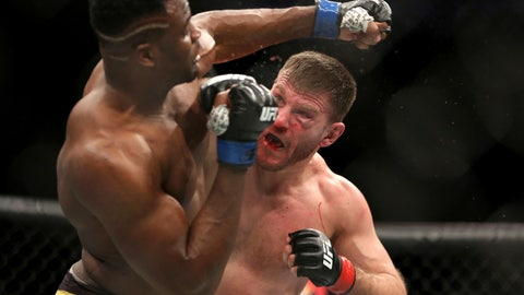 <p>               FILE - In this Jan. 21, 2018, file photo, Stipe Miocic, right, lands a right hand against Francis Ngannou during a heavyweight championship mixed martial arts bout at UFC 220 in Boston. Heavyweight champion Stipe Miocic welcomes the UFC's planned return. The fighter and firefighter does have some worries, though. (AP Photo/Gregory Payan, File)             </p>