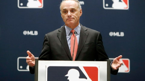 <p>               FILE - In this Nov. 21, 2019, file photo, baseball commissioner Rob Manfred speaks to the media at the owners meeting in Arlington, Texas. Major League Baseball is cutting the salary of senior staff by an average of 35% for this year and is guaranteeing paychecks to its full-time employees of its central office through May. Baseball Commissioner Rob Manfred made the announcement Tuesday, April 14, 2020.  (AP Photo/LM Otero, File)             </p>