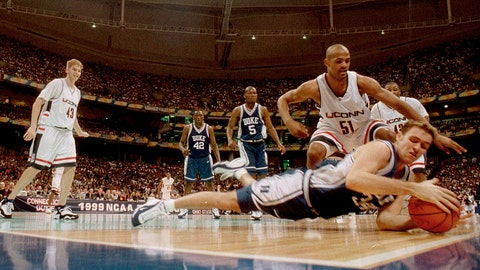 <p>               FILE - In this March 29, 1999, file photo, Duke's Chris Burgess tries to keep the ball from going out of bounds as Connecticut's Edmund Saunders (51) watches in the first half of the championship game of the NCAA college basketball Final Four, in St. Petersburg, Fla. UConn won 77-74. (AP Photo/Dave Martin, File)             </p>