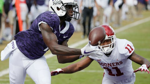 <p>               FILE - In this Oct. 20, 2018, file photo, TCU wide receiver Jalen Reagor (1) catches a pass in the end zone for a touchdown as Oklahoma cornerback Parnell Motley (11) defends during the first half of an NCAA college football game in Fort Worth, Texas. Reagor was selected by the Philadelphia Eagles in the first round of the NFL draft. (AP Photo/Brandon Wade, File)             </p>