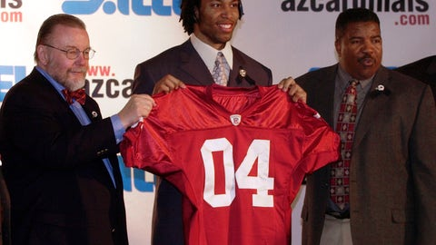 <p>               FLE - In this April 25, 2004, file photo, Arizona Cardinals owner Bill Bidwell, left, and coach Dennis Green, right, pose with first round NFL Draft pick wide receiver Larry Fitzgerald at a news conference in Tempe, Ariz. The Cardinals' franchise has been around for more than a century but current star receiver Larry Fitzgerald is arguably the most important player in franchise history. Fitzgerald has been a beloved piece of the Cardinals since he was drafted 3rd overall in 2004 and has been among the most productive receivers in NFL history with more than 17,000 career yards receiving.  (AP Photo/Tom Hood, File)             </p>