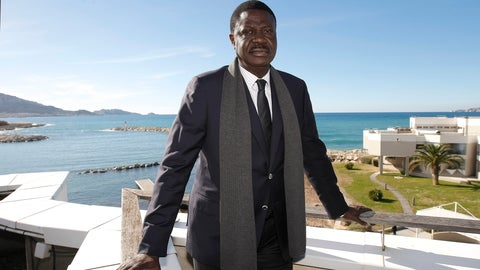 <p>               FILE - In this Feb.4, 2014 file photo, former president of Olympic Marseille soccer club, Pape Diouf, poses after a press conference, in Marseille, southern France. Pape Diouf, who led the French soccer club from 2005-09, has died after contracting the coronavirus. He was 68. (AP Photo/Claude Paris, File)             </p>
