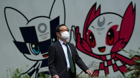 <p>               A man with a face mask against the spread of the new coronavirus walks in front of Miraitowa and Someity, mascots for the Tokyo 2020 Olympics and Paralympics at a park in Tokyo Tuesday, April 28, 2020. Japan's Prime Minister Shinzo Abe expanded a state of emergency to all of Japan from just Tokyo and other urban areas as the virus continues to spread. (AP Photo/Eugene Hoshiko)             </p>