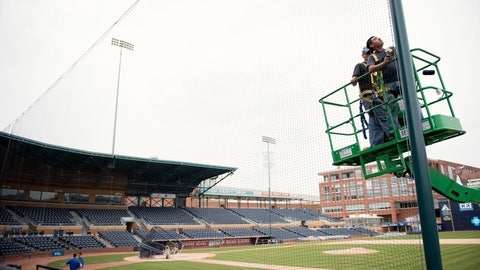 <p>               In this March 31, 2016, file photo, Elias Ruiz, front right, and Steven Woytysiak, both from C&H Baseball, help install a 35-foot-high safety netting that runs behind home plate and along the length of each dugout at the Durham Bulls Athletic Park in Durham, N.C. While Major League Baseball tries to figure out a way to play this summer, the prospects for anything resembling a normal minor league season are looking increasingly bleak. For minor league communities across the country, looking forward to cheap hot dogs, fuzzy mascot hugs and various theme nights, it's a small slice of a depressing picture. (Whitney Keller/The Herald-Sun via AP, File)             </p>