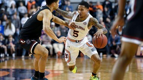 <p>               South Carolina guard Jair Bolden (52) defends Auburn guard J'Von McCormick (5) during the second half of an NCAA college basketball game Wednesday, Jan. 22, 2020, in Auburn, Ala. (AP Photo/Julie Bennett)             </p>